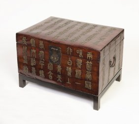 A Chinese Lacquered Leather Chest With Iron Lock And