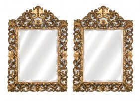 A Pair Of Louis Xv Style Carved Giltwood Mirrors,