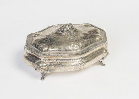 A German Silver Oval Casket With Engraved Floral