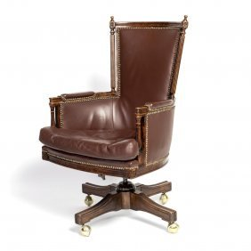 A Carved Studded Leather Upholstered Swivel Desk Chair,