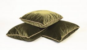 A Set Of Three Large Green Velvet Cushions With Rope