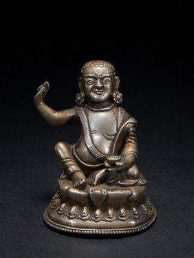 A Small Silver Figure Of Milarepa