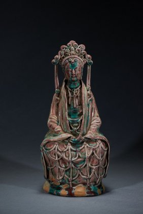 A Porcelain Figure Of Seated Guanyin