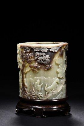 A Celadon Jade Brush Pot With Skin