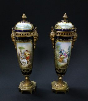 A PAIR OF SERVE STYLE BRONZE MOUNTED PAINTED AND GI