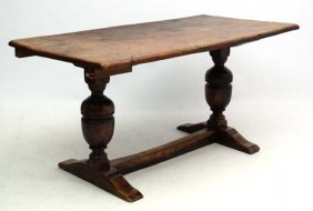 A 17thc Oak Trestle Table With Cup And Cover Columns