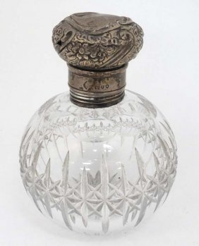 A Cut Glass Scent Bottle Of Spherical Form With Silver