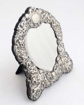 A Silver Mounted Easel Back Table Mirror With Silver