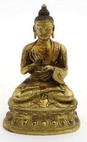 A 19thc Chinese Gilded Brass Buddhavista Sat Upon A