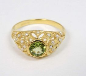 A Silver Gilt Ring Set With Central Peridot Set With