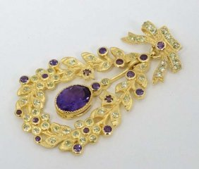 A Silver Gilt Pendant Set With Amethysts And Peridot.
