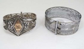 A White Metal Bracelet With Filigree Decoration