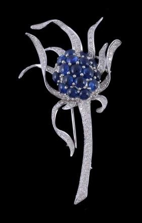 A Sapphire And Diamond Brooch, Designed As A Flower