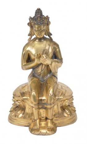 A Sino-Tibetan Gilt Bronze Seated Figure Of A Budd