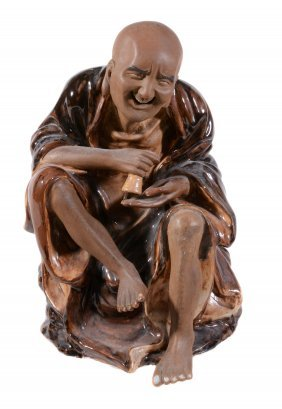 A Chinese Stoneware Seated Figure, With Brown Glazes