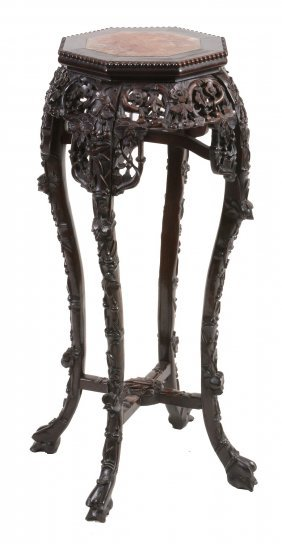 A Chinese Octagonal Carved Hardwood Stand, Early 20th