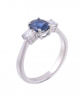 A Sapphire And Diamond Three Stone Ring, The Oval Cut
