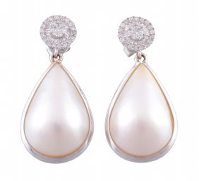 A Pair Of Diamond And Mabe Pearl Ear Pendents