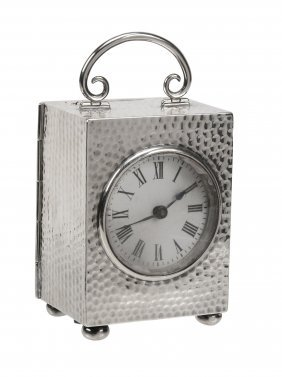 A Late Victorian Silver Cased Desk Clock By Douglas