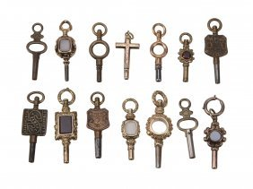 A Collection Of Fourteen Watch Keys, Including