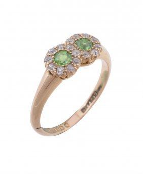 An 18 Carat Gold Demantoid Garnet And Diamond Ring,