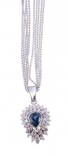 A Sapphire And Diamond Pendant, The Pear Shaped
