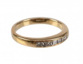 An 18 Carat Gold Diamond Ring, Set With Square Cut