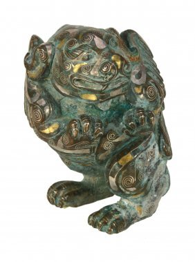 A Chinese Inlaid Bronze Of A Mythical Winged Beast,