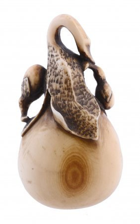 An Amusing Ivory Netsuke Of A Group Of Aubergines