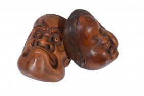 A Boxwood Mask Netsuke Carved To Represent Obeshimi's