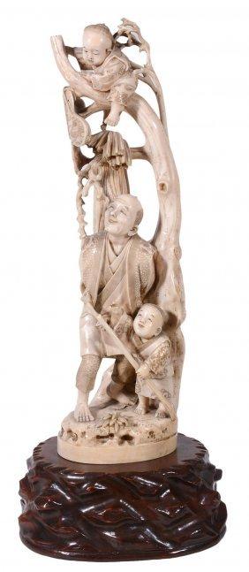 A Large Japanese Ivory Okimono, Depicting A Small Boy