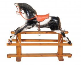 A Painted Wood Rocking Horse On A Pine Trestle Base ,