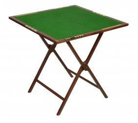 An Edwardian Mahogany And Inliad Folding Games Table,