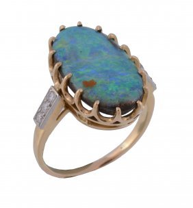 A Boulder Opal And Diamond Dress Ring, The Oval Shaped