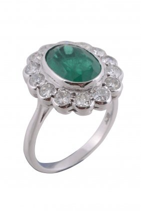 An Emerald And Diamond Cluster Ring, The Oval Cut