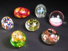 SEVEN COLLECTIBLE GLASS PAPERWEIGHTS