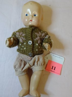 11'' MOLDED COMPOSITION BABY DOLL IN BOY'S CLOTHES