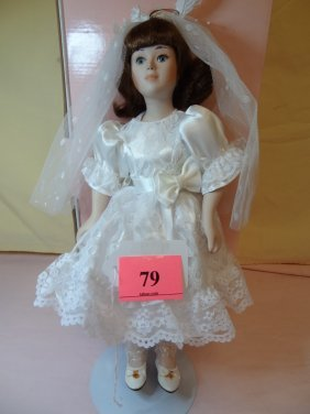 13'' BISQUE DOLL IN WHITE DRESS AND VEIL. DESIGNED