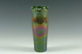 A CIRCA 1900 GREEN IRIDESCENT ART GLASS VASE