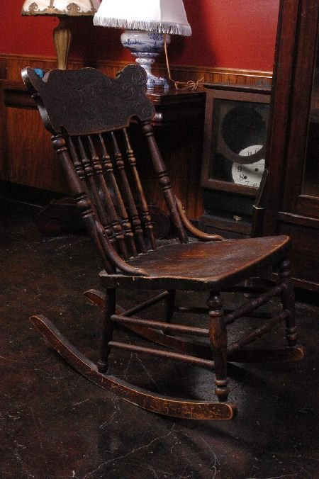 Antique Oak Pressed Back Rocking Chair With North Wind