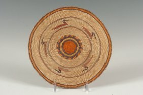 A MAKAH BASKETRY PLAQUE WITH BIRD FIGURES