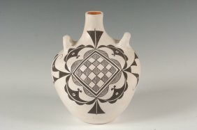 AN ACOMA POTTERY CANTEEN SIGNED M.T. ORTIZ