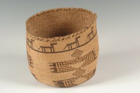 A SKOKOMISH STORAGE BASKET WITH FIGURES C. 1895