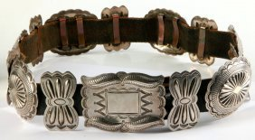 A Handsome Navajo Belt With Fourteen Silver Conchos