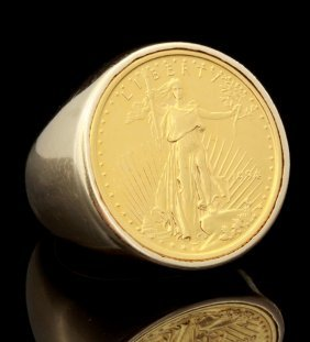 A Gent's 14k Gold Ring With 10 Dollar Liberty Coin
