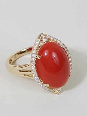 A 14k Yellow Gold Coral Ring With Diamonds