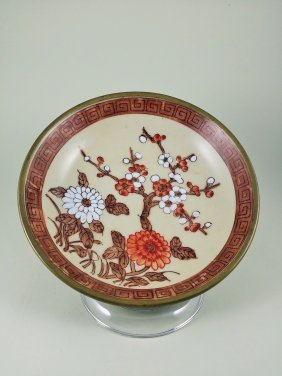 A Japanese Porcelain Plate With Cherry Blossoms