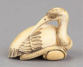 An Ivory Netsuke Of A Manchurian Crane