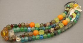 2 Strands Of Bohemian Vaseline Molded Glass Beads.