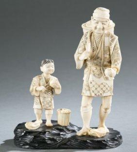 Japanese Okimono Of Farmer And Son.